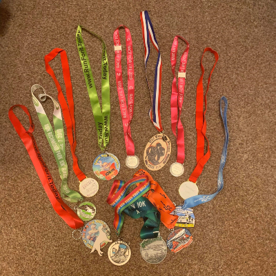 Hannah's 12 medals of the 12 events she ran this year.