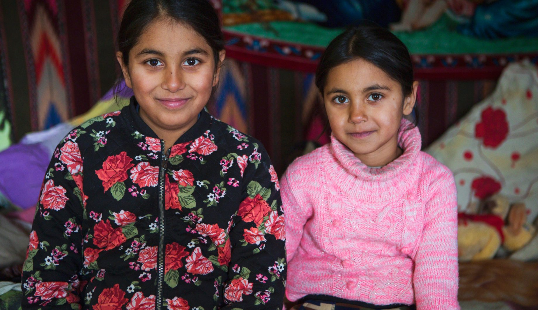 Sisters sitting in their home in northern Romania