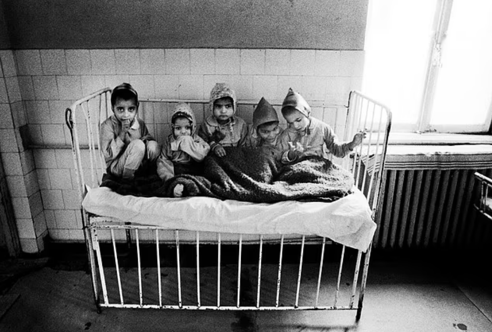 An orphanage in Bucharest, 1991: charity workers found starving children crammed into cots